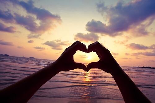 Heart-Hands-over-Sunset